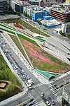 Aerial view looking north at Seattle's Olympic Sculpture Park.  Richard Serra's 'Wake' is the 5-piece sculpture at top left,  and Tony Smith's 'Stinger' is partly visible in lower left.  Elliott Avenue, a major thoroughfare, runs underneath the park as native summer wildflowers bloom in the meadow areas overhead.