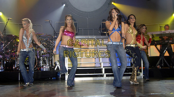GIRLS ALOUD - SARAH HARDING, CHERYL TWEEDY, NICOLA ROBERTS, KIMBERLEY WALSH & NADINE COYLE.Live at Carling Apollo, Hammersmith.May 28th, 2005.stage concert gig performance music full length dancing pink silver blue gold red metallic top jeans denim dancing  belly stomach midriff.www.capitalpictures.com.sales@capitalpictures.com.©Capital Pictures