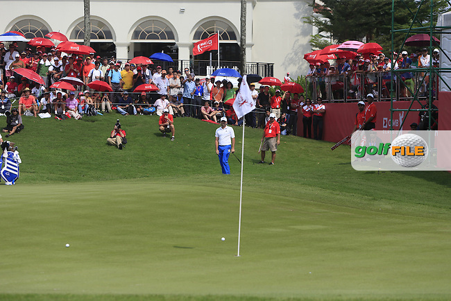 Sergio Garcia (ESP) chipping onto the 18th green during Round 4 of the CIMB Classic in the Kuala Lumpur Golf &amp; Country Club on Sunday 2nd November 2014.<br /> Picture:  Thos Caffrey / www.golffile.ie