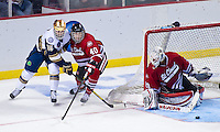 St. Cloud goalie Ryan Faragher stops a shot by Mike Voran (16) in the second period.