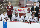 Adam Reasoner 30, Hockey Operations Director John Hegarty, Tim Filangieri 5, Carl Sneep 7, Mike Brennan 4 and Assistant Coach Greg Brown watch play. The Eagles of Boston College defeated the Falcons of Bowling Green State University 5-1 on Saturday, October 21, 2006, at Kelley Rink of Conte Forum in Chestnut Hill, Massachusetts.<br />