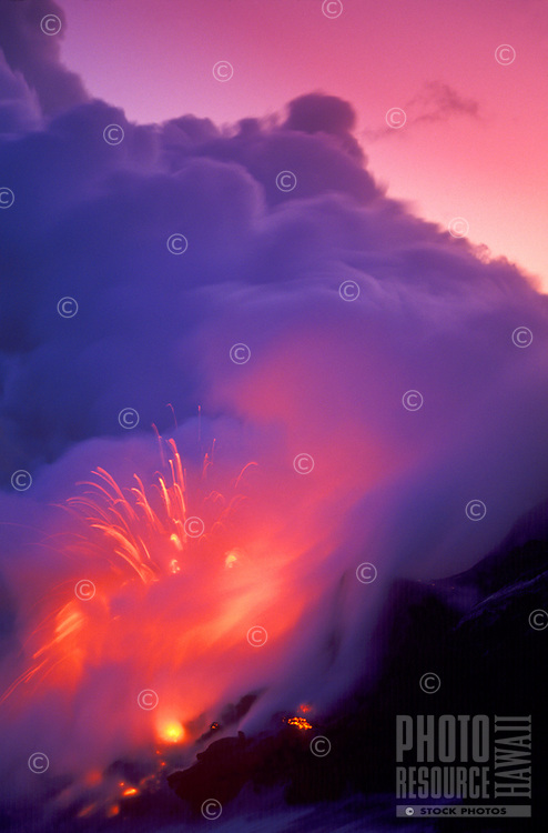 Lava flowing,exploding into the ocean at sunset.