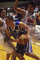 Aidan Daly and Damien Ekenasio try to stop Randall Bishop during the NBL Basketball match between the Wellington Saints and Bay Hawks, TSB Bank Arena, Wellington, New Zealand on Saturday, 10 May 2008. Photo: Dave Lintott / lintottphoto.co.nz