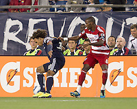 New England Revolution defender Kevin Alston (30) controls the ball as FC Dallas midfielder Jackson Goncalves (6) defends. In a Major League Soccer (MLS) match, the New England Revolution defeated FC Dallas, 2-0, at Gillette Stadium on September 10, 2011.