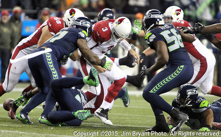 Arizona Cardinals quarterback Cason Palmer (3) is stripped of the ball by Seattle Seahawks linebacker Bruce Irvin (51) at CenturyLink Field in Seattle, Washington on November 15, 2015. The Cardinals beat the Seahawks 39-32.   ©2015. Jim Bryant photo. All Rights Reserved.