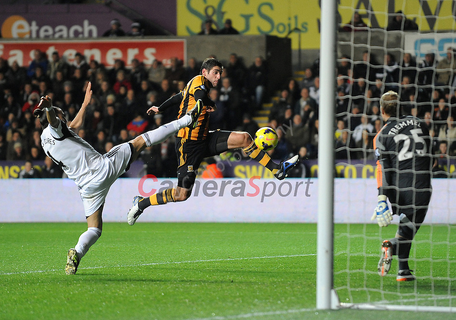 Hull City's Danny Graham scores his sides first goal  <br /> <br /> Photo by Ian Cook/CameraSport<br /> <br /> Football - Barclays Premiership - Swansea City v Hull City - Monday 9th December 2013 - The Liberty Stadium - Swansea<br /> <br /> &copy; CameraSport - 43 Linden Ave. Countesthorpe. Leicester. England. LE8 5PG - Tel: +44 (0) 116 277 4147 - admin@camerasport.com - www.camerasport.com