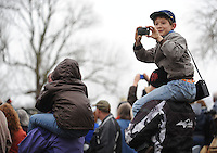 NWA Media/ANDY SHUPE - Sawyer Condie, 9, of Tahlequah, Okla., takes photographs from atop the shoulders of his father, Jason Condie, while watching a re-enactment of the Battle of Prairie Grove Saturday, Dec. 6, 2014, at Battlefield State Park in Prairie Grove. This is the 152nd anniversary of the battle which took place Dec. 7, 1862 between 12,000 Confederate and 10,000 Federal soldiers. Visit nwamedia.photoshelter.com to see more photographs from the battle.