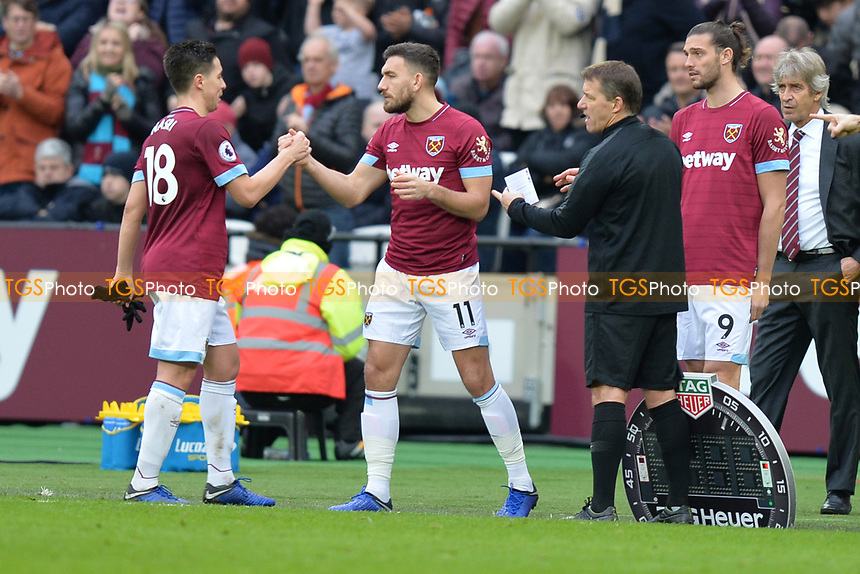 Samir Nasri of West Ham United and Robert Snodgrass of West Ham United during West Ham United vs Arsenal, Premier League Football at The London Stadium on 12th January 2019