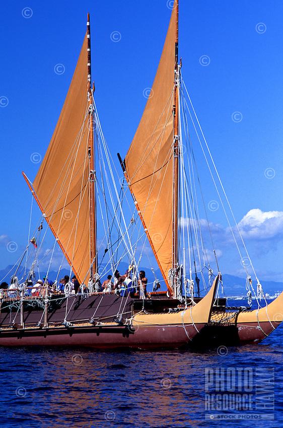 Polynesian voyaging canoe Hokulea in open ocean off the island of Oahu