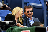 FLUSHING NY- SEPTEMBER 09: ***NO NY DAILIES*** Michael J. Fox and his wife Tracy Pollan sit in their seats for The Madison Keys and Sloane Stephens match. Stephens defeats Keys in straight sets 6-3, 6-0 during the Womens finals on Arthur Ashe Stadium at the US Open in the USTA Billie Jean King National Tennis Center on September 9, 2017 in Flushing Queens. <br /> CAP/MPI04<br /> &copy;MPI04/Capital Pictures