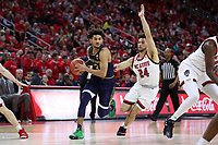 RALEIGH, NC - JANUARY 9: Prentiss Hubb #3 of the University of Notre Dame is chased by Devin Daniels #24 of North Carolina State University during a game between Notre Dame and NC State at PNC Arena on January 9, 2020 in Raleigh, North Carolina.