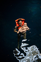 Eunice Adorno with her one year old daughter Emiliana swimming at the Nah Yah cenote in Yucatan, Mexico