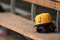 Jacksonville Suns hat and glove sit in the dugout during a game against the Pensacola Blue Wahoos on April 20, 2014 at Bragan Field in Jacksonville, Florida.  Jacksonville defeated Pensacola 5-4.  (Mike Janes/Four Seam Images)