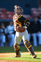 Bethune-Cookman Wildcats catcher Michael Cruz (15) throws to first during a game against the Wisconsin-Milwaukee Panthers on February 26, 2016 at Chain of Lakes Stadium in Winter Haven, Florida.  Wisconsin-Milwaukee defeated Bethune-Cookman 11-0.  (Mike Janes/Four Seam Images)