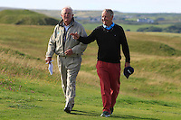 Arthur Pierse (Tipperary) walks up the 18th fairway with old friend Charlie Mulqueen after beating John-Ross Galbraith (Whitehead) 2&1 during Matchplay Round 2 of the South of Ireland Amateur Open Championship at LaHinch Golf Club on Friday 22nd July 2016.<br />