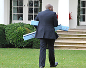 Washington, D.C. - December 15, 2009 -- Reggie Love, Special Assistant to United States President Barack Obama walks through the Rose Garden with boxes of track lighting he seemingly purchased from a Home Depot in Alexandria, Virginia where the President made remarks earlier on Tuesday, December 15, 2009..Credit: Ron Sachs / Pool via CNP