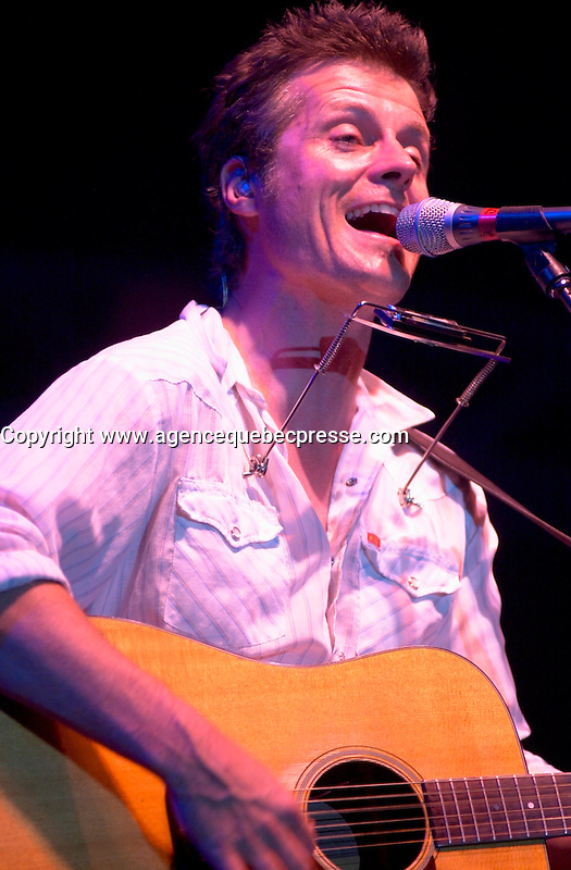 July 1 2002, Montreal, Quebec, Canada<br /> Canadian Rock Group Blue Rodeo, perform a free outdoor concert for the Canada day celebrations,  July 1st 2001, in the Old-Port of Montreal. <br /> <br /> Mandatory Credit: Photo by Pierre Roussel- Images Distribution. (&copy;) Copyright 2002 by Pierre Roussel <br /> <br /> NOTE l Nikon D-1 jpeg opened with Qimage icc profile, saved in Adobe 1998 RGB. Original file size available in TIFF file.