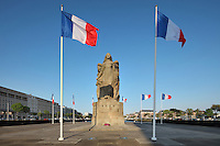 Figure of Victory on the Monument aux morts et a la Victoire, sculpture by Pierre-Marie Poisson, opened 1924, a memorial to the 6000 citizens of Le Havre who died in the First World War, whose names are inscribed on the base, Le Havre, Normandy, France. The monumental sculpture depicts Victory leading various allegorical figures, both civic and military. On the left are apartment blocks designed by Auguste Perret, 1874-1954, who led the reconstruction of Le Havre in the 1950s, after the town was completely destroyed in WWII. The centre of Le Havre is listed as a UNESCO World Heritage Site. Picture by Manuel Cohen