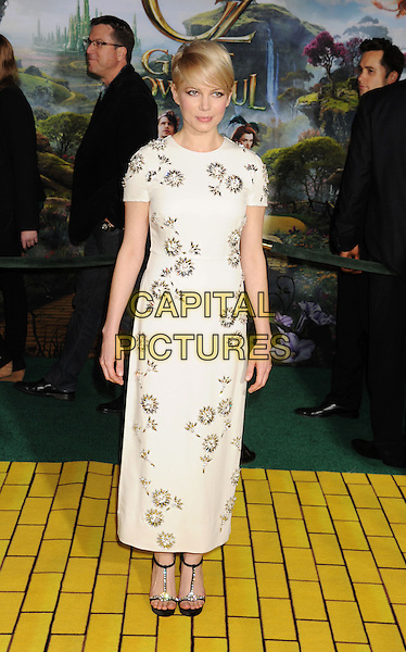 """Michelle Williams.at the world premiere of Disney's """"OZ The Great And Powerful"""" at El Capitan Theatre in Hollywood, California on February 13th, 2013. .full length white dress short sleeved flowers black sandals open toe ankle strap  diamante  t-bar embellished jewelled beaded .CAP/ROT/TM.©Tony Michaels/Roth Stock/Capital Picturess"""