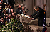 December 5, 2018 - Washington, DC, United States: Former U.S. President George W. Bush pauses for a moment while giving a eulogy during the state funeral service of his father, former President George W. Bush at the National Cathedral.  <br /> Credit: Chris Kleponis / Pool via CNP