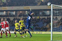 Simon Eastwood of Oxford United saves from a free kick during the Sky Bet League 1 match between Oxford United and Fleetwood Town at the Kassam Stadium, Oxford, England on 10 April 2018. Photo by David Horn.