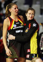 Nicola Pettit (right) consoles Casey Williams after the loss during the ANZ Netball Championship match between the Waikato Bay of Plenty Magic and Adelaide Thunderbirds, Mystery Creek Events Centre, Hamilton, New Zealand on Sunday 19 July 2009. Photo: Dave Lintott / lintottphoto.co.nz