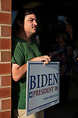 A supporter of 2020 Democratic Presidential candidate Joe Biden holds a campaign sign as he waits for Biden to arrive for the opening of a campaign office in Iowa City, Iowa on Wednesday, August 7, 2019. Biden is kicking off a 4 day tour of Iowa. Credit: Alex Edelman / CNP