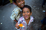 Children playing on the streets of Varanasi, Uttar Pradesh, India. These images were made as part of a personal project on the handloom weavers in Varanasi. In these, I focused on the education of the weaver's children.I am grateful to the help I received from the People's Vigilance Committee on Human Rights (PVCHR).