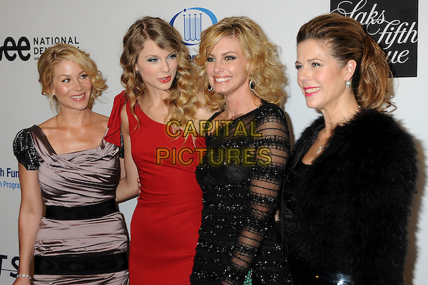 CHRISTINA APPLEGATE, TAYLOR SWIFT, FAITH HILL & RITA WILSON.EIF's Women's Cancer Research Fund Benefit held at the Beverly Wilshire Hotel, Beverly Hills, California, USA..January 27th, 2010.half length red one shoulder wavy hair dress black sheer fur purple beige grey gray silk satin .CAP/ADM/BP.©Byron Purvis/AdMedia/Capital Pictures.
