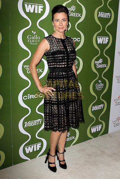 Linda Cardellini<br /> Variety &amp; Women In Film Pre-Emmy Event presented by Yoplait Greek held at Scarpetta, Beverly Hills, California, USA, <br /> 20th September 2013.<br /> full length black dress sleeveless hands on hips <br /> CAP/ADM/KB<br /> &copy;Kevan Brooks/AdMedia/Capital Pictures