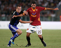 SK Slovan Bratislava midfielder Erik Grendel, left, challenges AS Roma midfielder Simone Perrotta during an Europa League preliminary second leg football match between AS Roma and SK Slovan Bratislava, at Rome's Olympic stadium, Roma, 25 august 2011..UPDATE IMAGES PRESS/Riccardo De Luca