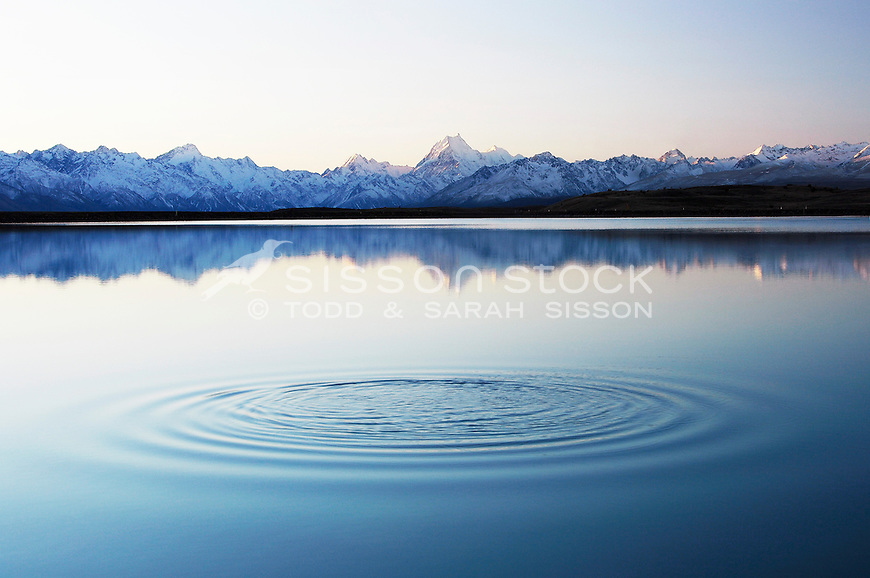 A tranquil ripple in the Tekapo canal with Mount Cook / Aoraki and the Southern Alps.