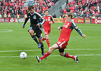 24 March 2012: Toronto FC defender Ty Harden #20 and San Jose Earthquakes forward Chris Wondolowski #8 in action during a game between the San Jose Earthquakes and Toronto FC at BMO Field in Toronto..The San Jose Earthquakes won 3-0..