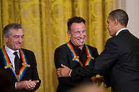 06 Dec 2009, Washington, DC, USA --- US President Barack Obama shakes hands with singer and songwriter Bruce Springsteen as actor, director, and producer Robert De Niro (L) looks on during a reception for Kennedy Center Honorees in the East Room of the White House in Washington, DC --- Image by © Brooks Kraft/Corbis