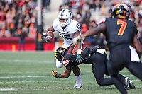 College Park, MD - November 3, 2018:  Maryland Terrapins defensive back Antoine Brooks Jr. (25) tackles Michigan State Spartans running back La'Darius Jefferson (15) during the game between Michigan St. and Maryland at  Capital One Field at Maryland Stadium in College Park, MD.  (Photo by Elliott Brown/Media Images International)