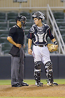 Kannapolis Intimidators catcher Brett Austin (10) looks at home plate umpire Jeff Gorman during the game against the Charleston RiverDogs at CMC-NorthEast Stadium on June 27, 2014 in Kannapolis, North Carolina.  The Intimidators defeated the RiverDogs 6-5.  (Brian Westerholt/Four Seam Images)