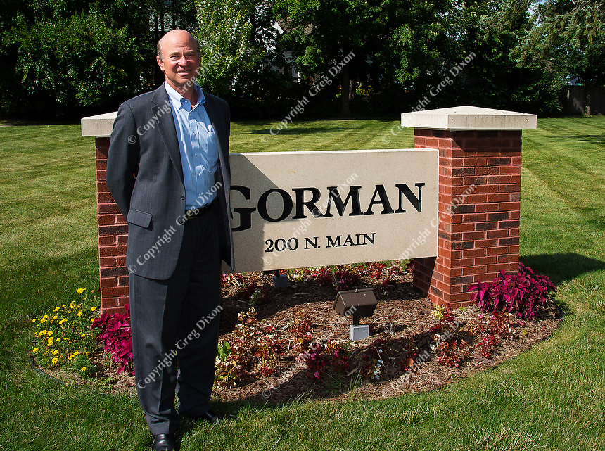 Gary Gorman stands by the sign at Gorman & Company's headquarters in Oregon, Wisconsin on Wednesday, July 17, 2013