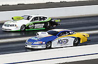 Feb. 16, 2013; Pomona, CA, USA; NHRA pro stock driver Steve Kent (near lane) races alongside Deric Kramer during qualifying for the Winternationals at Auto Club Raceway at Pomona.. Mandatory Credit: Mark J. Rebilas-