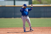 Chicago Cubs catcher Alex Guerra (6) asks for time during an Extended Spring Training game against the Los Angeles Angels at Sloan Park on April 14, 2018 in Mesa, Arizona. (Zachary Lucy/Four Seam Images)