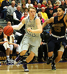 SIOUX FALLS, SD - JANUARY 2:  Zach Wessels #11 from the University of Sioux Falls drives past Jordan Spencer #23 from Augustana in the first half of their game Friday night at the Stewart Center. (Photo by Dave Eggen/Inertia)