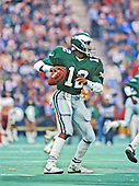 Philadelphia Eagles quarterback Randall Cunningham (12) looks for a receiver during the game against the Washington Redskins at Veterans Stadium in Philadelphia, Pennsylvania on November 8, 1987.  The Eagles won the game 31 - 27.<br /> Credit: Arnie Sachs / CNP