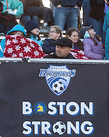 Breaker's fans in the new stands at Dilboy getting cozy at halftime.  In a National Women's Soccer League Elite (NWSL) match, the Boston Breakers defeated  Chicago Red Stars 4-1, at the Dilboy Stadium on May 4, 2013.