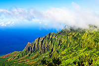 View above the clouds from the Kalalau Lookout at Koke'e State Park, Na Pali Coast, Kaua'i.
