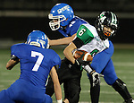 SIOUX FALLS, SD - OCTOBER 23: Eric Hanson #6 from McCook Central Montrose weaves his way between Tannen Reu #7 and Caleb Ruiter #45 from Sioux Falls Christian in the first half of their game Thursday night at Bob Young Field. (Photo by Dave Eggen/Inertia)