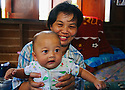 Thai Baby and mother, Damnoen Saduak, Thailand