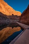 The Pier at Rainbow Bridge  &copy;2017 James D. Peterson.  I recently had the great fortune to spend a couple days on Lake Powell with a good friend.  It was a fine trip in ideal weather for boating, and the beauty of that territory is pretty much indescribable. <br /> <br /> Rainbow Bridge is only accessible by boat (well, I guess you can also get there by backpacking a long distance, but my backpacking days are ancient history), and most photographers who go there head straight for the bridge to capture some images.  That, in fact, is what I did initially too.  But it's also a good idea to look around and make sure you don't miss the beauty to be found in other directions.<br /> <br /> I waited for some nice sunrise light to hit the bridge itself, but it's situated between canyon walls that blocked the early morning sunbeams.  Back at the pier, however, that glorious light was pouring into the canyon, making the walls glow and also creating a nice reflection in the water.  And in addition to the sublime light, I loved the geometry of the resulting scene.  So did my camera.