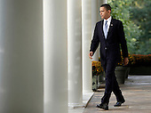 Washington, DC - October 14, 2009 -- United States President Barack Obama walks out from the Oval Office of the White House in Washington, DC to deliver remarks on the Senate Finance Committee's vote to approve health insurance reform legislation on Tuesday, October 13, 2009. .Credit: Yuri Gripas / Pool via CNP