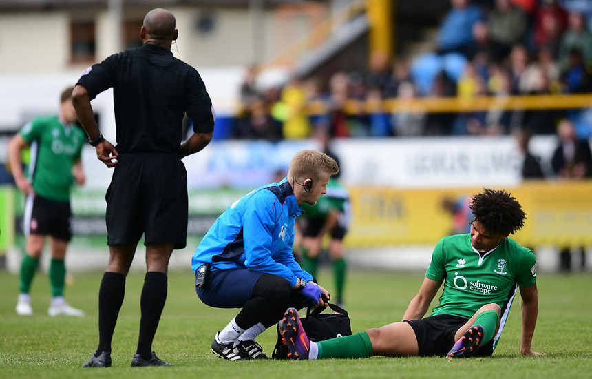 Lincoln City's Lee Angol receives treatment for an injury from Lincoln City's head of sports science and medicine Mike Hine<br /> <br /> Photographer Chris Vaughan/CameraSport<br /> <br /> Vanarama National League - Southport v Lincoln City - Saturday 29th April 2017 - Merseyrail Community Stadium - Southport<br /> <br /> World Copyright &copy; 2017 CameraSport. All rights reserved. 43 Linden Ave. Countesthorpe. Leicester. England. LE8 5PG - Tel: +44 (0) 116 277 4147 - admin@camerasport.com - www.camerasport.com