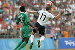 13 August 2008: Brian McBride (USA) (17) heads the ball in front of Dele Adeleye (NGA) (5).  The men's Olympic team of Nigeria defeated the men's Olympic soccer team of the United States 2-1 at Beijing Workers' Stadium in Beijing, China in a Group B round-robin match in the Men's Olympic Football competition.