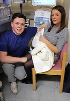 "COPY BY TOM BEDFORD<br /> Pictured: Luc Protheroe with partner Paighton Waters and their prematurely born baby at the Royal Gwent Hospital in Newport, Wales, UK<br /> Re: A young couple were granted their Christmas wish to cwtch their ""miracle"" baby for the first time.<br /> Little Flynn Protheroe was the same size as a mobile phone when he was born 14 weeks early.<br /> The tiny baby and his mother Paighton Waters, 19, were both given a 50-50 chance of surviving after a rare placental abruption.<br /> Flynn was born by Caesarian and doctors worked on him for 20 minutes to get his tiny heart and lungs working.<br /> Meanwhile Paighton was on the critical list after losing four litres of blood.<br /> But five weeks later the pair are doing well and have been allowed to hold their little boy for a Christmas cuddle.<br /> Proud dad Luc Protheroe, 21, said: ""It's a miracle, I could have lost them both."